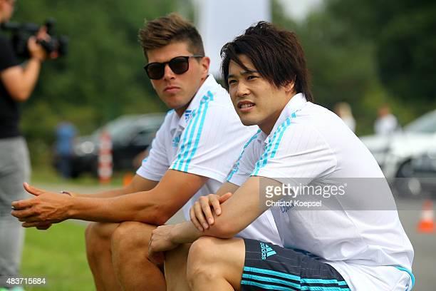 KlaasJan Huntelaar and Atsuto Uchida pose during a test drive of Schalke at driving safety centre Rheinberg on August 12 2015 in Rheinberg