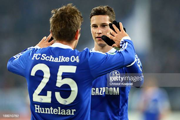 KlaasJan Huntelaar celebrates the third goal with Julian Draxler of Schalke during the DFB Cup second round match between FC Schalke 04 and SV...