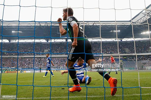 KlaasJan Huntelaar of FC Schalke 04 celebrates after he shoots and scores a goal in the opening minutes past Goalkeeper Michael Ratajczak of MSV...