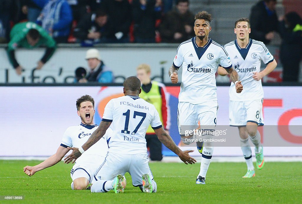 Klaas-Jan Huntelaar of FC Schalke 04 celebrates with teammate Jefferson Farfan after heading his team's second goal during the Bundesliga match between Bayer Leverkusen and FC Schalke 04 at BayArena on February 15, 2014 in Leverkusen, Germany.