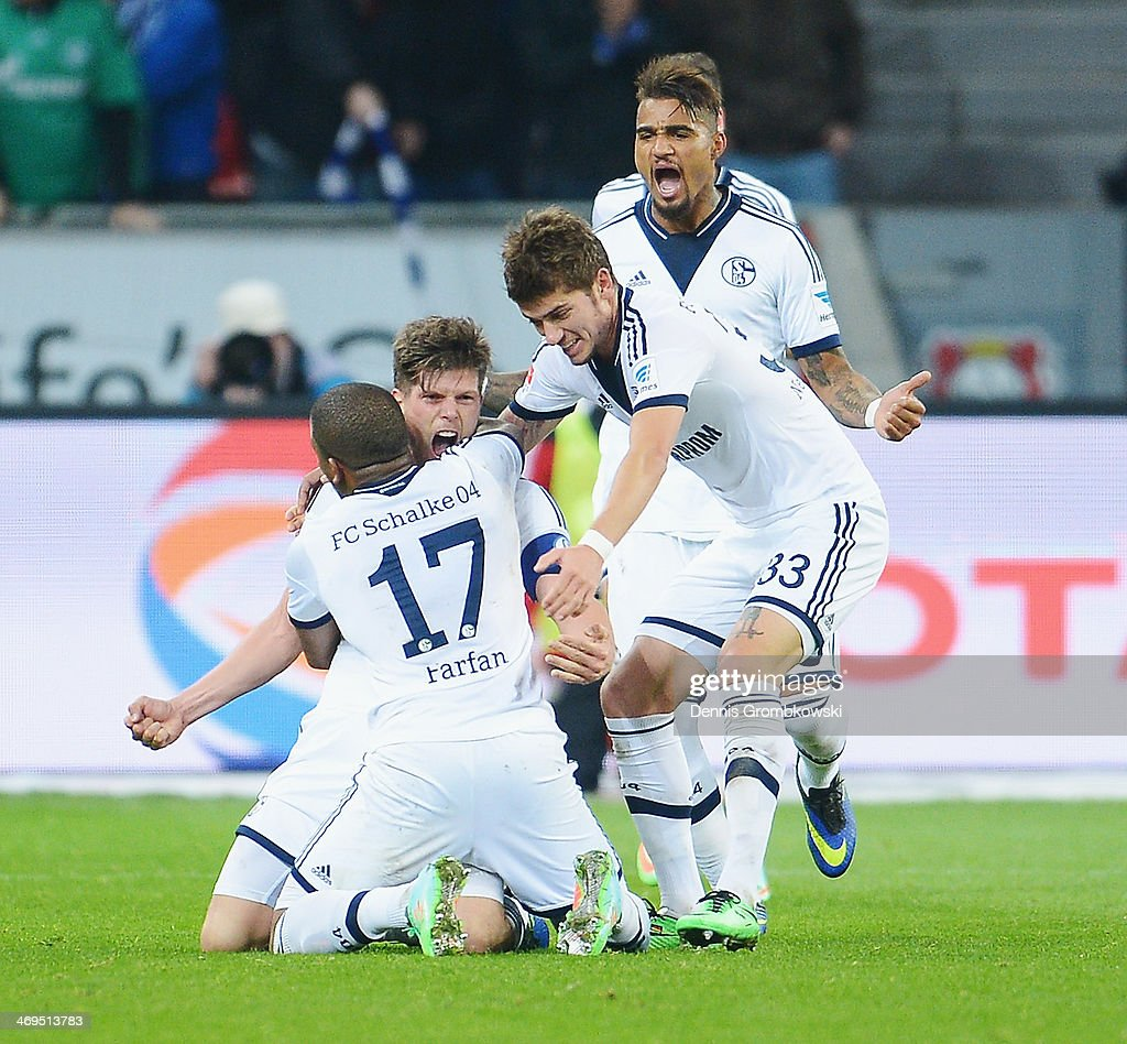 Klaas-Jan Huntelaar of FC Schalke 04 celebrates with teammate <a gi-track='captionPersonalityLinkClicked' href=/galleries/search?phrase=Jefferson+Farfan&family=editorial&specificpeople=791155 ng-click='$event.stopPropagation()'>Jefferson Farfan</a> after heading his team's second goal during the Bundesliga match between Bayer Leverkusen and FC Schalke 04 at BayArena on February 15, 2014 in Leverkusen, Germany.