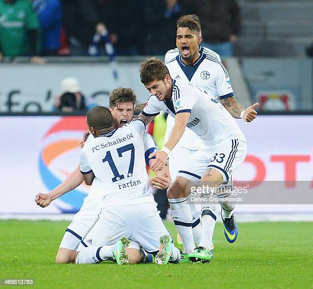KlaasJan Huntelaar of FC Schalke 04 celebrates with teammate Jefferson Farfan after heading his team's second goal during the Bundesliga match...