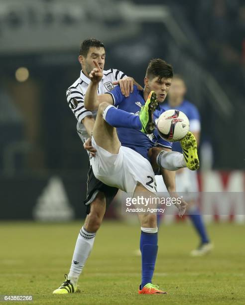 KlaasJan Huntelaar of FC Schalke 04 in action with Evgen Shakhov of PAOK FC during their UEFA Europa League round of 32 soccer match between FC...