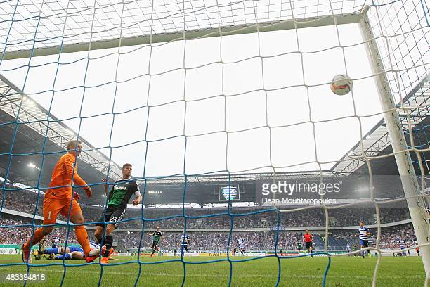 KlaasJan Huntelaar of FC Schalke 04 shoots and scores a goal in the opening minutes past Goalkeeper Michael Ratajczak of MSV Duisburg during the DFB...