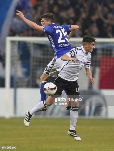 KlaasJan Huntelaar of Schalke and Achilleas Pouggouras of PAOK battle for the ball during the UEFA Europa League Round of 32 second leg match between...