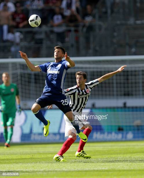 KlaasJan Huntelaar of Schalke and David Abraham of Frankfurt battle for the ball during the Bundesliga match between Eintracht Frankfurt and FC...