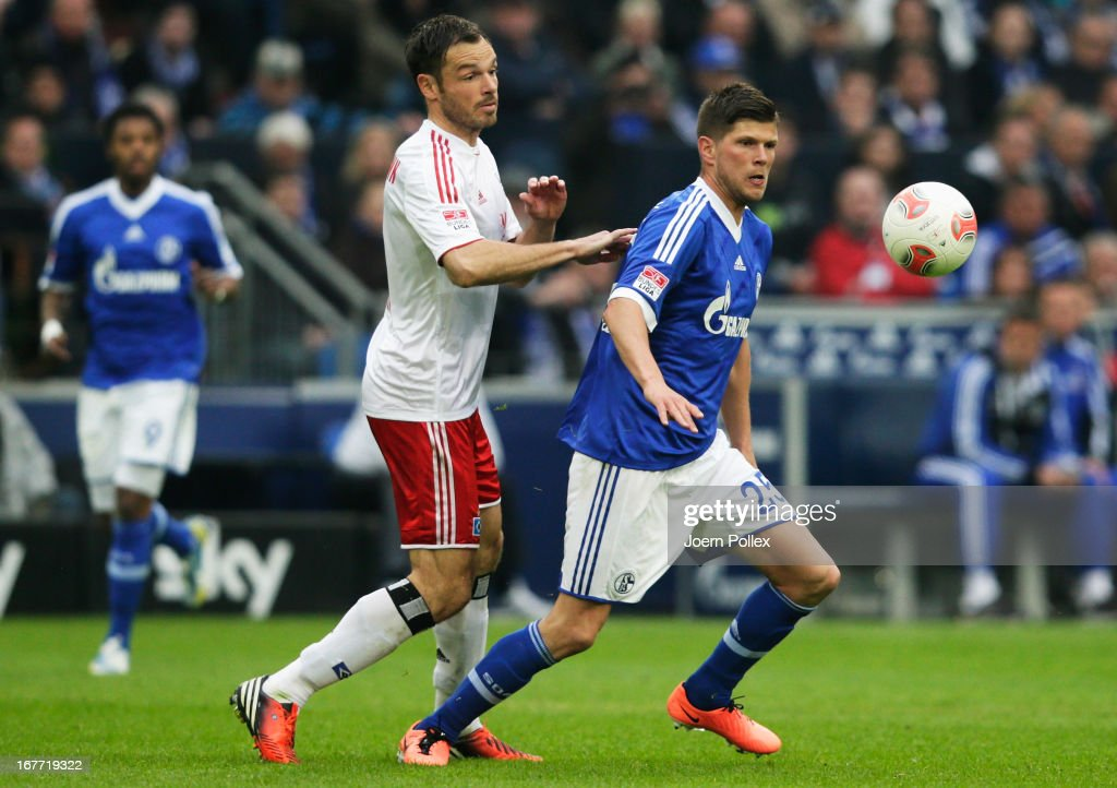 Klaas-Jan Huntelaar (R) of Schalke and <a gi-track='captionPersonalityLinkClicked' href=/galleries/search?phrase=Heiko+Westermann&family=editorial&specificpeople=623650 ng-click='$event.stopPropagation()'>Heiko Westermann</a> of Hamburg compete for the ball during the Bundesliga match between FC Schalke 04 and Hamburger SV at Veltins-Arena on April 28, 2013 in Gelsenkirchen, Germany.