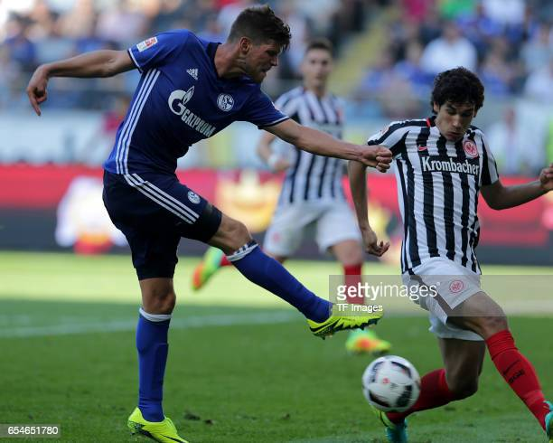 KlaasJan Huntelaar of Schalke and Jesus Vallejo of Frankfurt battle for the ball during the Bundesliga match between Eintracht Frankfurt and FC...