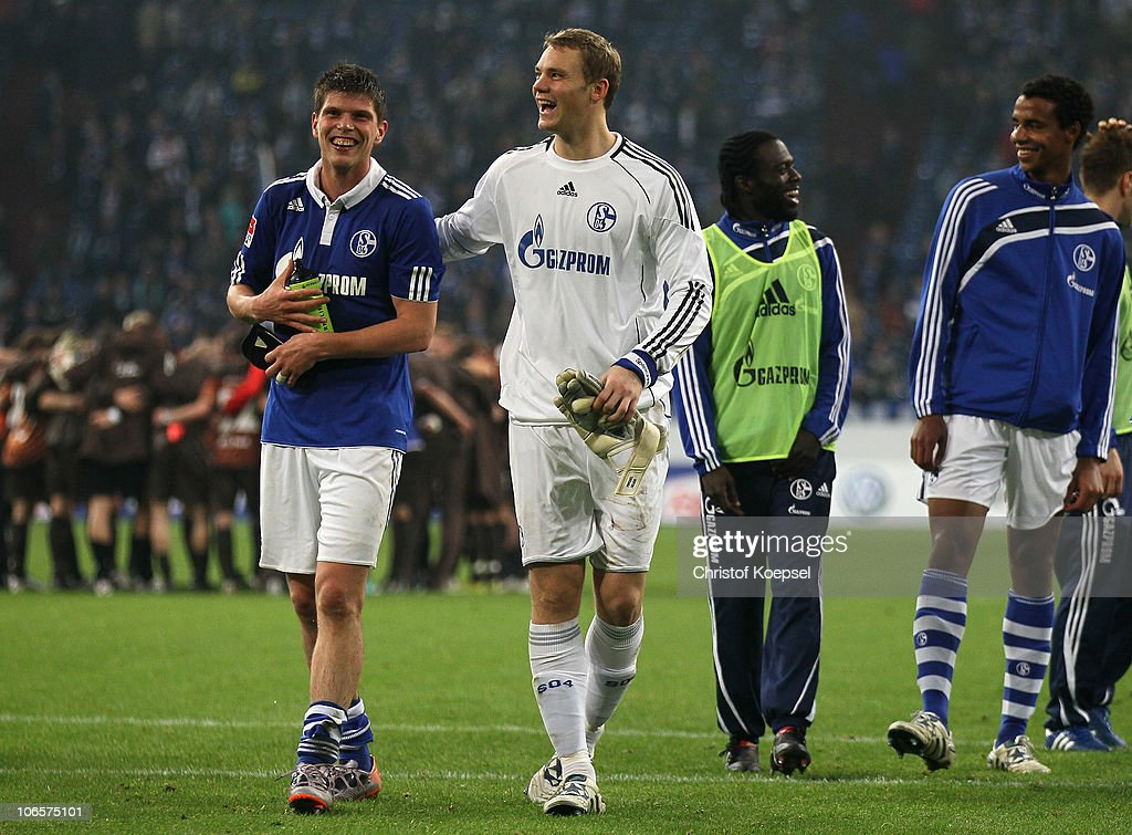 Klaas-Jan Huntelaar of Schalke and <a gi-track='captionPersonalityLinkClicked' href=/galleries/search?phrase=Manuel+Neuer&family=editorial&specificpeople=764621 ng-click='$event.stopPropagation()'>Manuel Neuer</a> of Schalke celebrate the 3-0 victory after the Bundesliga match between FC Schalke 04 and FC St. Pauli at Veltins Arena on November 5, 2010 in Gelsenkirchen, Germany.