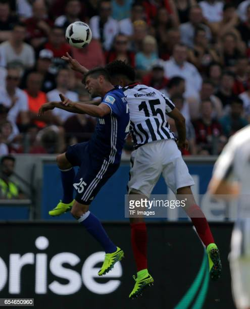 KlaasJan Huntelaar of Schalke and Michael Hector of Frankfurt battle for the ball during the Bundesliga match between Eintracht Frankfurt and FC...