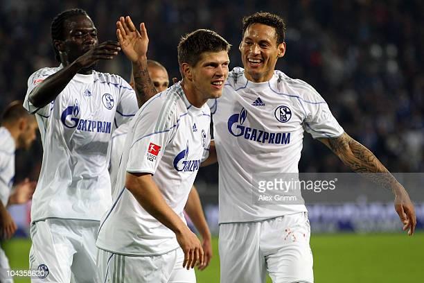 KlaasJan Huntelaar of Schalke celebrates his team's second goal with team mates Hans Sarpei and Jermaine Jones during the Bundesliga match between SC...