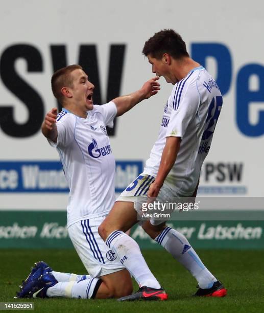 KlaasJan Huntelaar of Schalke celebrates his team's second goal with team mate Lewis Holtby during the Bundesliga match between 1 FC Kaiserslautern...
