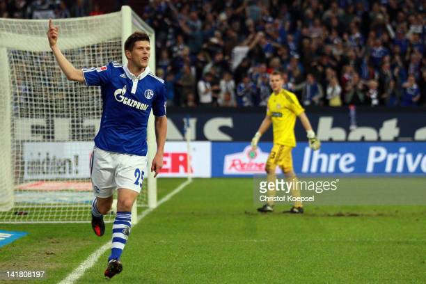 KlaasJan Huntelaar of Schalke celebrates the first goal during the Bundesliga match between FC Schalke 04 and Bayer 04 Leverkusen at Veltins Arena on...