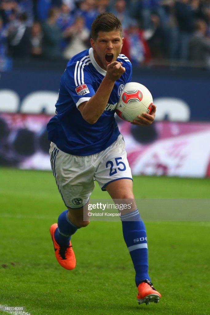 Klaas-Jan Huntelaar of Schalke celebrates the second goal during the Bundesliga match between FC Schalke 04 and Hamburger SV at Veltins-Arena on April 28, 2013 in Gelsenkirchen, Germany.