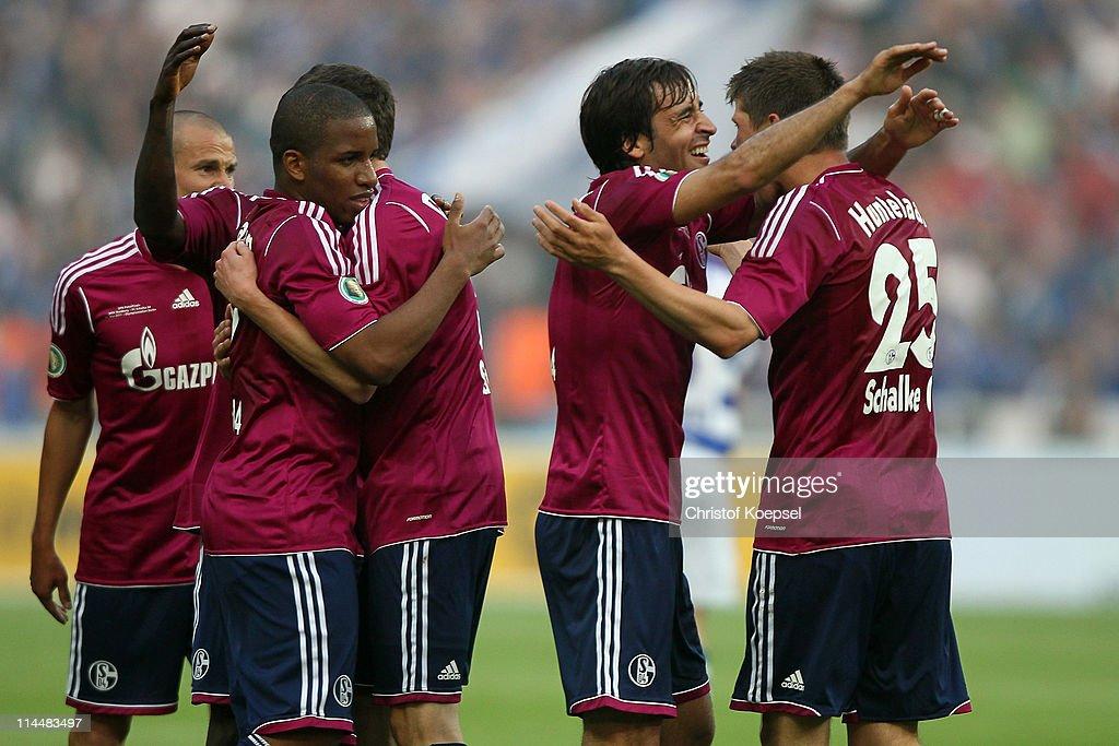 KlaasJan Huntelaar of Schalke celebrates the second goal with Raúl Gonzalez of Schalke during the DFB Cup final match between MSV Duisburg and FC...