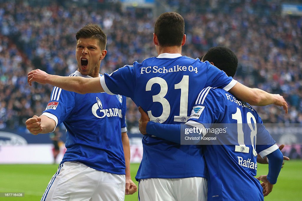 Klaas-Jan Huntelaar of Schalke celebrates the second goal with <a gi-track='captionPersonalityLinkClicked' href=/galleries/search?phrase=Roman+Neustaedter&family=editorial&specificpeople=5437402 ng-click='$event.stopPropagation()'>Roman Neustaedter</a> and Raffael of Schalke during the Bundesliga match between FC Schalke 04 and Hamburger SV at Veltins-Arena on April 28, 2013 in Gelsenkirchen, Germany.
