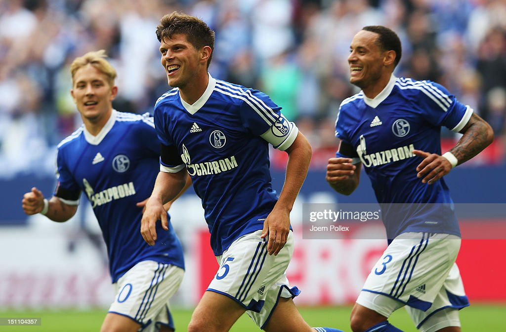 Klaas-Jan Huntelaar (C) of Schalke celebrates with his team mates after scoring his team's third goal during the Bundesliga match between FC Schalke 04 and FC Augsburg at Veltins-Arena on September 1, 2012 in Gelsenkirchen, Germany.