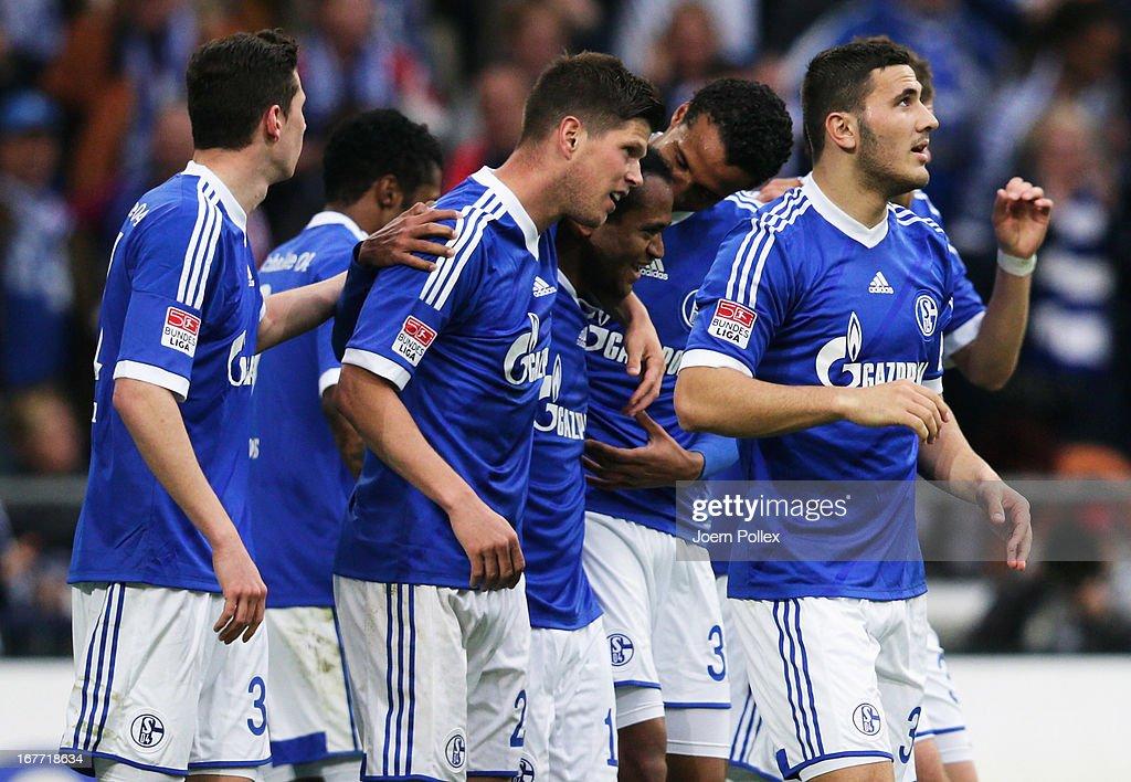 Klaas-Jan Huntelaar (3rd L) of Schalke celebrates with his team mates after scoring his team's third goal during the Bundesliga match between FC Schalke 04 and Hamburger SV at Veltins-Arena on April 28, 2013 in Gelsenkirchen, Germany.