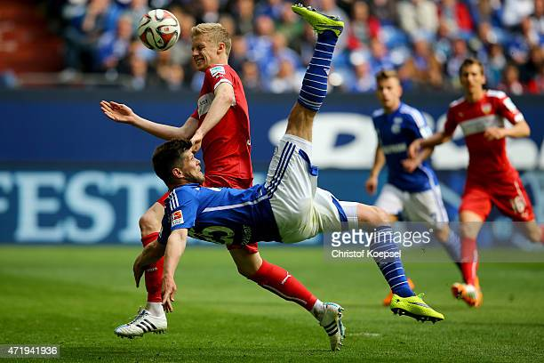 KlaasJan Huntelaar of Schalke does an overhead kick against Timo Baumgartl of Stuttgart during the Bundesliga match between FC Schalke 04 and VfB...