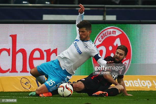 KlaasJan Huntelaar of Schalke is challenged by Marc Stendera of Frankfurt during the Bundesliga match between Eintracht Frankfurt and FC Schalke 04...