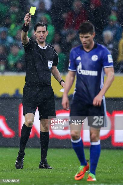 KlaasJan Huntelaar of Schalke is snown a yellow card by referee during the Bundesliga match between Borussia Moenchengladbach and FC Schalke 04 at...