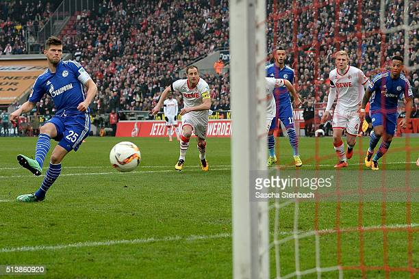 KlaasJan Huntelaar of Schalke scores the opening goal from a penalty during the Bundesliga match between 1 FC Koeln and FC Schalke 04 at...