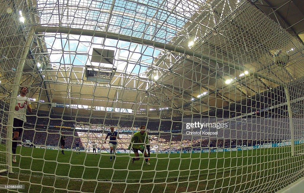KlaasJan Huntelaar of Schalke scores the third goal against RonRobert Zieler of Hannover during the Bundesliga match between FC Schalke 04 and...