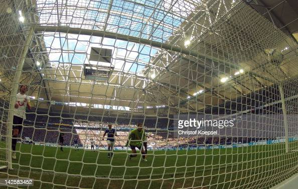 KlaasJan Huntelaar of Schalke scores the third goal against RonRobert Zieler of Hannover during the Bundesliga match between FC Schalke 04 and...