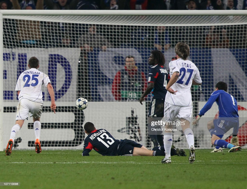 Klaas-Jan Huntelaar of Schalke (L) scores the third goal during the UEFA Champions League group B match between FC Schalke 04 and Olympique Lyonnais at Veltins Arena on November 24, 2010 in Gelsenkrichen, Germany.