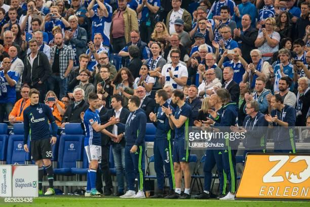 KlaasJan Huntelaar of Schalke shake hands with team mates after his replacement during the Bundesliga match between FC Schalke 04 and Hamburger SV at...