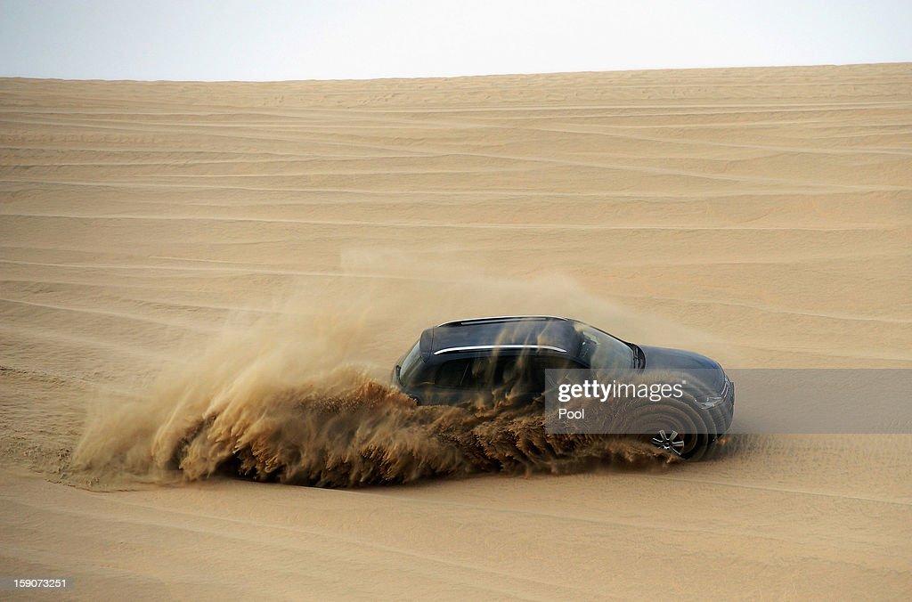 Klaas-Jan Huntelaar of Schalke steers a VW Touareg during a trip to the desert outside Doha at the Schalke 04 training camp on January 7, 2013 in Doha, Qatar.