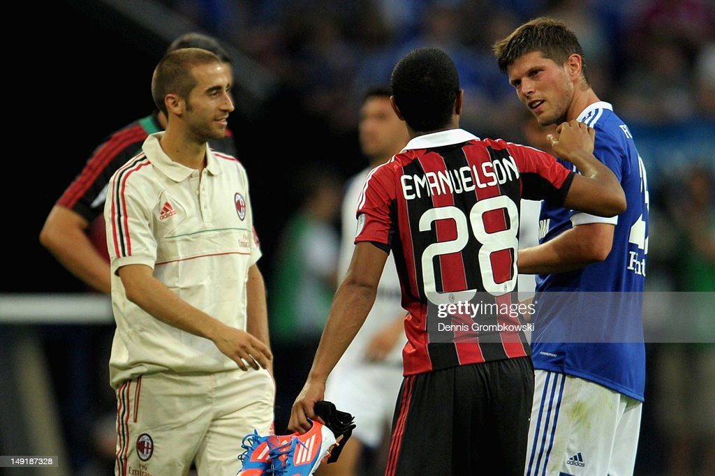 Klaas-Jan Huntelaar of Schalke talks to <a gi-track='captionPersonalityLinkClicked' href=/galleries/search?phrase=Urby+Emanuelson&family=editorial&specificpeople=594399 ng-click='$event.stopPropagation()'>Urby Emanuelson</a> of Milan after the friendly match between Schalke 04 and AC Milan at Veltins-Arena on July 24, 2012 in Gelsenkirchen, Germany.