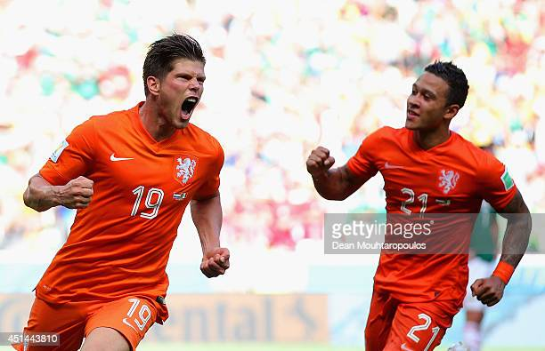 KlaasJan Huntelaar of the Netherlands celebrates scoring his team's second goal on a penalty kick in stoppage time with Memphis Depay during the 2014...