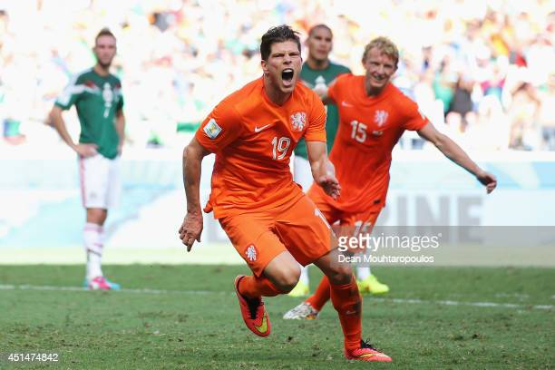 KlaasJan Huntelaar of the Netherlands celebrates scoring his team's second goal on a penalty kick in stoppage time during the 2014 FIFA World Cup...