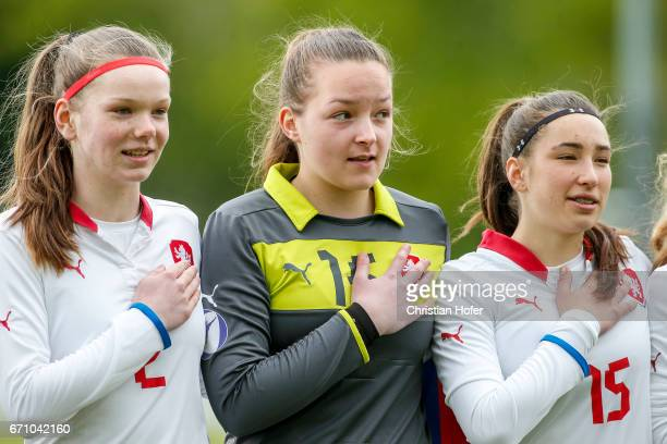 Klara Bazoutova goalkeeper Nikola Kucerova and Anna Subrtova of Czech Republic line up during the national anthem prior to the Under 15 girls...