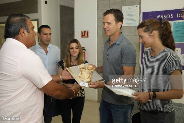 Klara Bierhoff and Oliver Bierhoff team manager of the German national team receive gifts during the visit and unveiling of plaque for the economic...