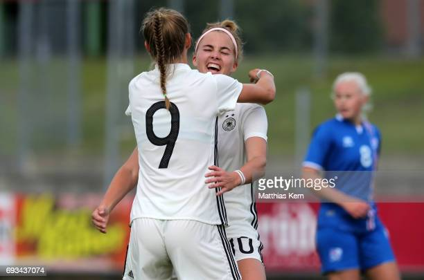 Klara Buehl of Germany jubilates with Laura Freigang after scoring the first goal during the U19 women's elite round match between Germany and...