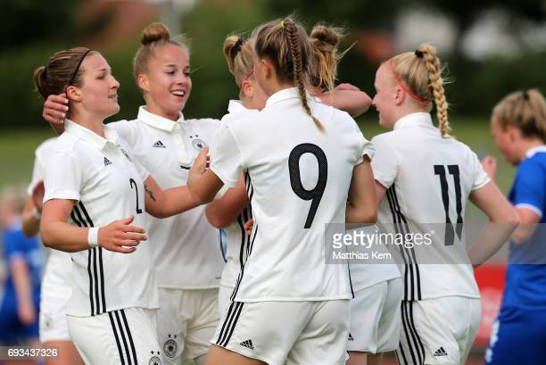Klara Buehl of Germany jubilates with team mates after scoring the first goal during the U19 women's elite round match between Germany and Iceland at...