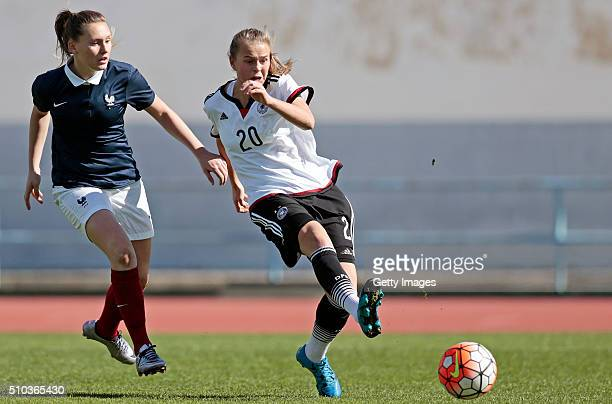 Klara Buhl of Germany callenges Verena Wieder of France and scores during the match of the U16 Girl's Germany v U16 Girl's France UEFA Tournament on...