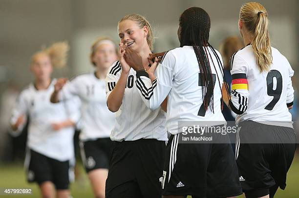 GLASGOW SCOTLAND OCTOBER Klara Buhl of Germany is congratulated by Etonam Nicole Anyomi of Germany during the International Challenge Match between...