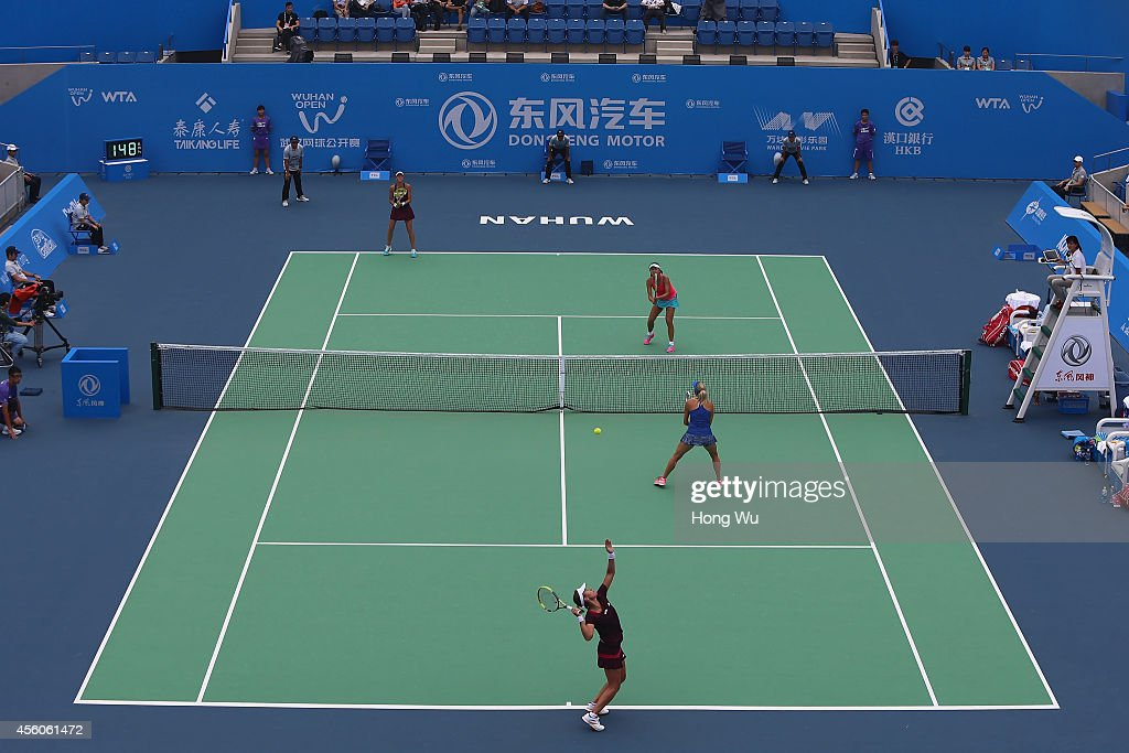 Klara Koukalova of Czech and Anabel Medina Garrigues of Spain in action during the doubles match against Andrea Hlavackova of Czech and Shuai Peng of...
