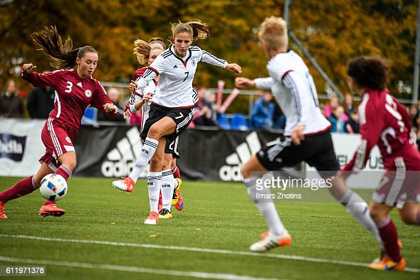 Klara Melissa Kossler of Germany is challenged by Diana Skribina of Latvia during the UEFA Under17 Girl's Euro Qualifier match Germany and Latvia at...
