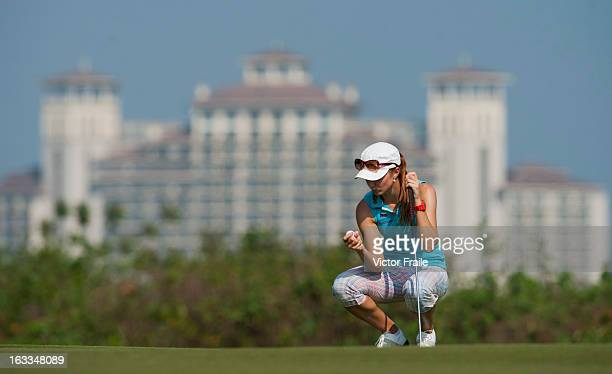 Klara Spilkova of Czech Republic lines up a putt on the 14th green during day two of the Mission Hills World Ladies Championship at Mission Hills'...