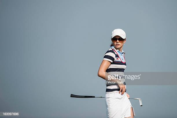 Klara Spilkova of Czech Republic lines up a putt on the 14th hole at Mission Hills' Blackstone Course on March 9 2013 in Hainan Island China