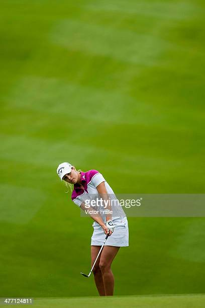 Klara Spilkova of Czech Republic plays a third shot on the 6th hole during round one of the World Ladies Championship at Mission Hills' Blackstone...