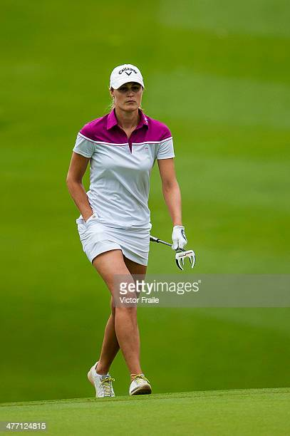 Klara Spilkova of Czech Republic walks on the 6th hole during round one of the World Ladies Championship at Mission Hills' Blackstone Course on March...