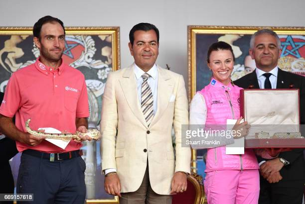 Klara Spilkova of The Czech Republic and Edourdo Molinari of Italy celebrate as they are awarded their trophies after Eduoardo Molinari won the...
