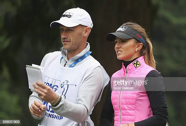 Klara Spilkova of the Czech Republic chats with her caddie during the first round of the KPMG Women's PGA Championship at the Sahalee Country Club on...