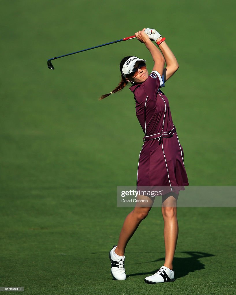Klara Spilkova of The Czech Republic plays her second shot at the par 4, 14th hole during the third round of the 2012 Omega Dubai Ladies Masters on the Majilis Course at the Emirates Golf Club on December 7, 2012 in Dubai, United Arab Emirates.