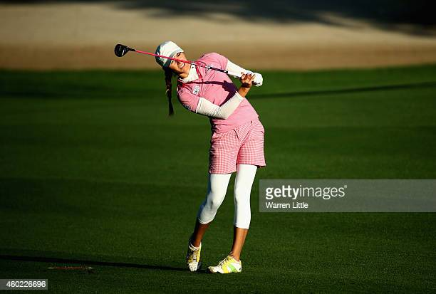 Klara Spilkova of the Czech Republic plays her second shot on the 10th hole during the first round of the Omega Dubai Ladies Maters on the Majlis...